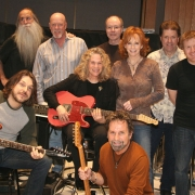 Pictured in the photo with Carole and Reba are: L-R top row: Leland Sklar (bass), Russ Kunkel (drums), Dean Parks (guitar), J.D. Maness (steel). Matt Rollings (piano).  L-R bottom row: Tom Bukovac (guitar), Tony Brown (producer). Photo by Glenn Sweitzer