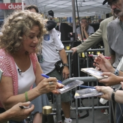 Signing albums & CD's.Photo by Elissa Kline