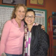 Carole with Keiko Agena in between takes on the set of Gilmore Girls - Nov. 2005. Photo by CKP