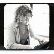 Carole plays piano.  Photo by Jim Wright