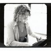 Carole plays piano.  Photo by Jim Wright